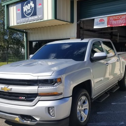 Silver Chevy Silverado with windshield tint done by 100% Tint