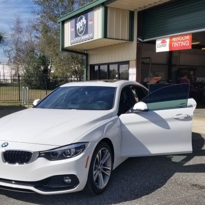 white bmw 4 series gran coupe with window tint in Jacksonville FL