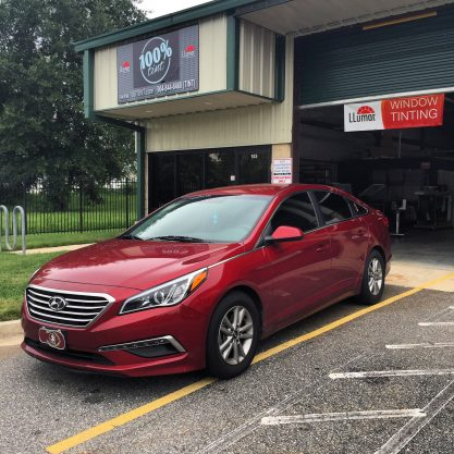 Red Hyundai with window tint done at 100% Tint in Jacksonville, FL