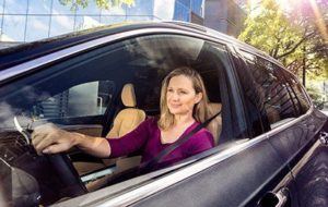 Women driving a car with clear window tint 100% Tint Jacksonville, FL